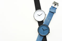 Black and blue wristwatches. Isolated on white background Royalty Free Stock Photo