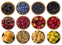 Black-blue, yellow and red berries isolated on white background. Collage of different fruits and berries. Cherry, strawberry, pomegranate, currant, raspberry Stock Image