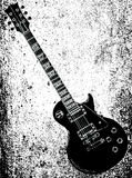 Black Blues Guitar Grunge. A definitive rock and roll guitar in black isolated over a white and grunge background Royalty Free Stock Image