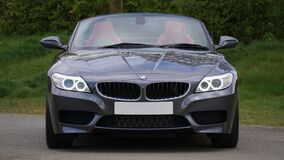 Black Bmw Convertible in Front of Green Bushes Stock Photography