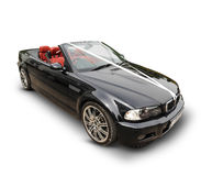 Black BMW sports car with white ribbons. Black BMW convertible sports car with top down draped in white wedding ribbons with red leather seats Royalty Free Stock Photos