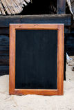 Black board. On the bach in the sand Stock Photo