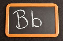 A black board with the alphabet letter B. In a capital and small letter Royalty Free Stock Image