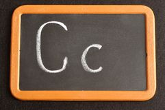 A black board with the alphabet letter C. In a capital and small letter Royalty Free Stock Image