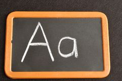 A black board with the alphabet letter A. In a capital and small letter Stock Images