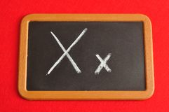 A black board with the alphabet letter X. In a capital and small letter Stock Photography