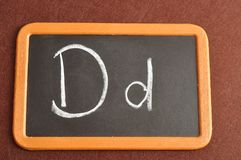 A black board with the alphabet letter D. In a capital and small letter Royalty Free Stock Photo