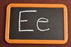 A black board with the alphabet letter E. In a capital and small letter Stock Photos