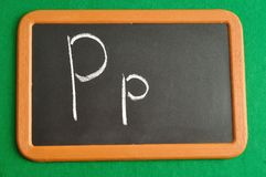 A black board with the alphabet letter P. In a capital and small letter Stock Image