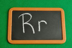 A black board with the alphabet letter R. In a capital and small letter Royalty Free Stock Images
