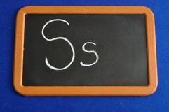 A black board with the alphabet letter S. In a capital and small letter Royalty Free Stock Image