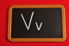 A black board with the alphabet letter V. In a capital and small letter Royalty Free Stock Photo