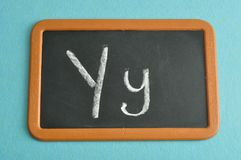 A black board with the alphabet letter Y. In a capital and small letter Royalty Free Stock Photos