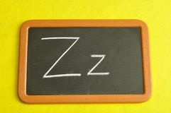 A black board with the alphabet letter Z. In a capital and small letter Stock Images