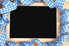 Black board with bavarian girland Stock Images