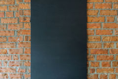 Black board on brick wall background Royalty Free Stock Image