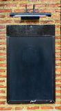 Black board on brick wall Stock Photo