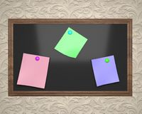 Black board in brown frame with colored stickers for notes Royalty Free Stock Photography