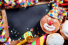 Black Board with Carnival Donuts and Props Royalty Free Stock Photo