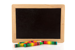 Black board with chalks Royalty Free Stock Images