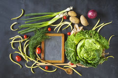 Black board and food ingredients, cooking concept Stock Photo