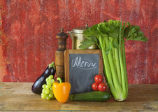 Black board for menu and vegetables Royalty Free Stock Image