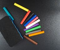 Black board with a multiple chalks Royalty Free Stock Photos