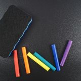 Black board with a multiple chalks Royalty Free Stock Image