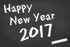 Black board for New Year 2017 greetings. Greetings on black board with text Happy New Year 2017 Royalty Free Stock Image