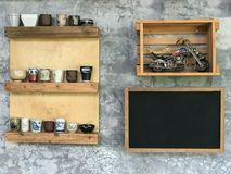 Black board for note hang on wall with ceramic cup and motocycle. Toy Royalty Free Stock Image