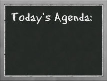 Black board showing agenda Stock Images