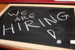 Black board showing we are hiring royalty free stock photo