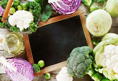 Black Board Surrounded by Healthy fresh Vegetables Royalty Free Stock Photo