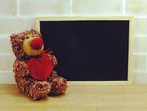 Black board with teddy bear valentine`s day concept Royalty Free Stock Photos
