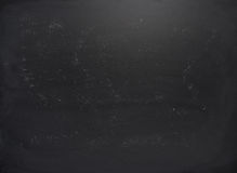 Black board with the traces of chalk. Over its surface as a background texture Royalty Free Stock Images