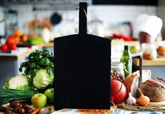 Black Board with vegetables and bread Stock Image