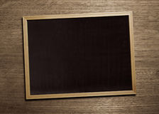 Black board on wood table. Blank blackboard for delivery message Stock Photos
