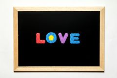 Black board with wording love. On white background Royalty Free Stock Photography