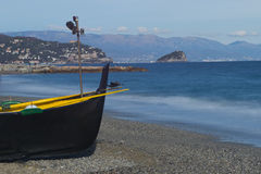 Black Boat on the Beach Stock Photography