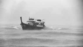 Black Boat Sailing While Raining Stock Photography