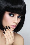 Black bob and manicure. Young beautiful sexy woman with stylish bob haircut and black manicure Royalty Free Stock Photography