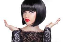 Black bob short hairstyle. Brunette girl model with Open hands Stock Photography