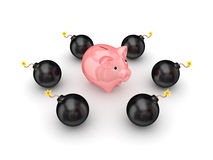 Black bombs around pink piggy bank. Stock Photo