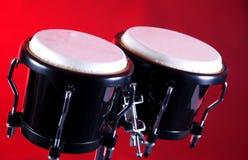 Black Bongo Set On Red Royalty Free Stock Photos