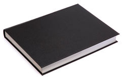 Black book. Generic hard bound black book with blank cover, isolated on white background stock photo