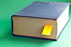 This is black book with big yellow bookmark. It is theme of reading Stock Images