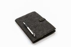 Black book case and pen . Royalty Free Stock Photos
