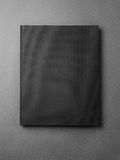 Black book cover on the gray background. Vertical Royalty Free Stock Images