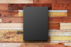 Black book cover on a vintage wooden surface Stock Photo