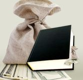 Black book and dollars. Stock Images